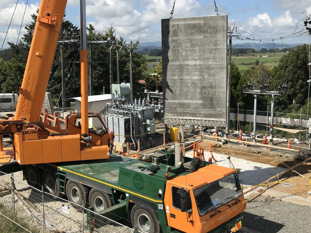 The 130-tonne crane lifts the first/last of the pre-cast fire wall panels into place at Te Waireka