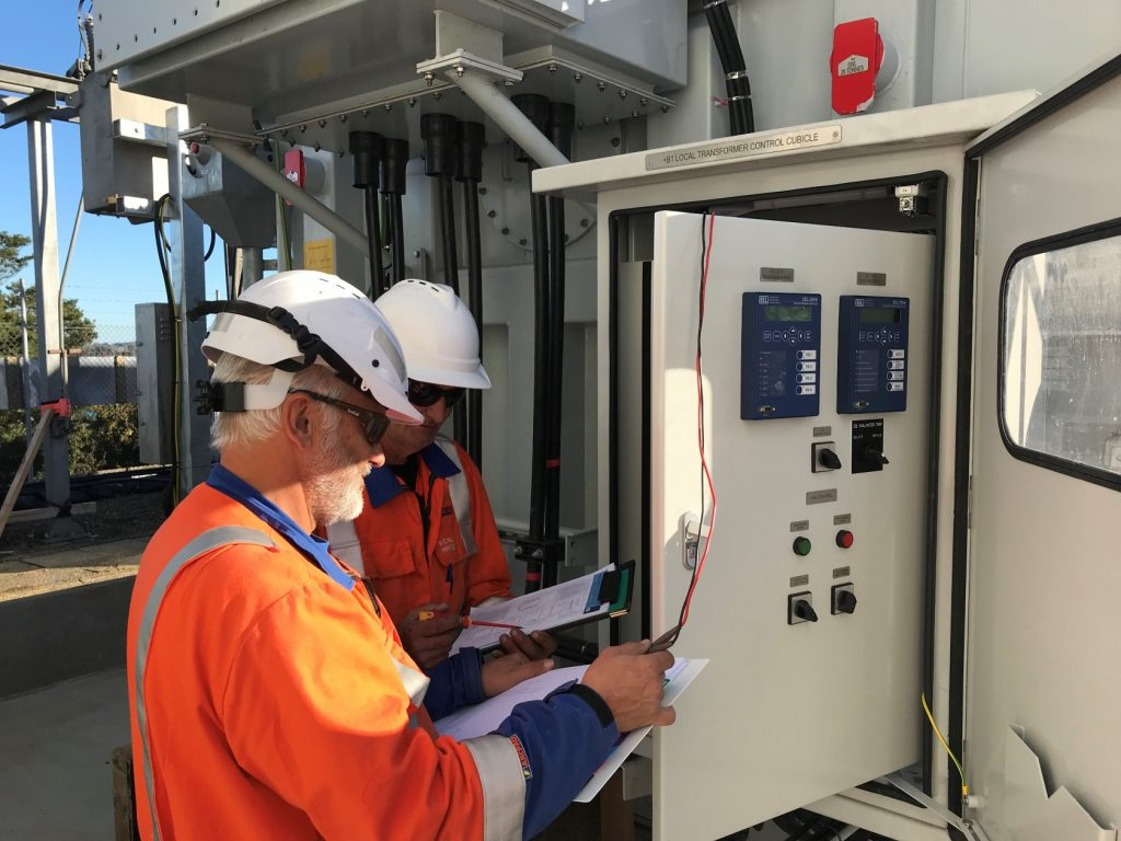 TLC's John La Roche (left) and Eric Leineweber (right) during final testing of the first transformer at Te Waireka.