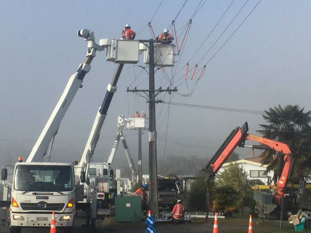 Line mechanics upgrading other of Otorohanga's lines in August this year