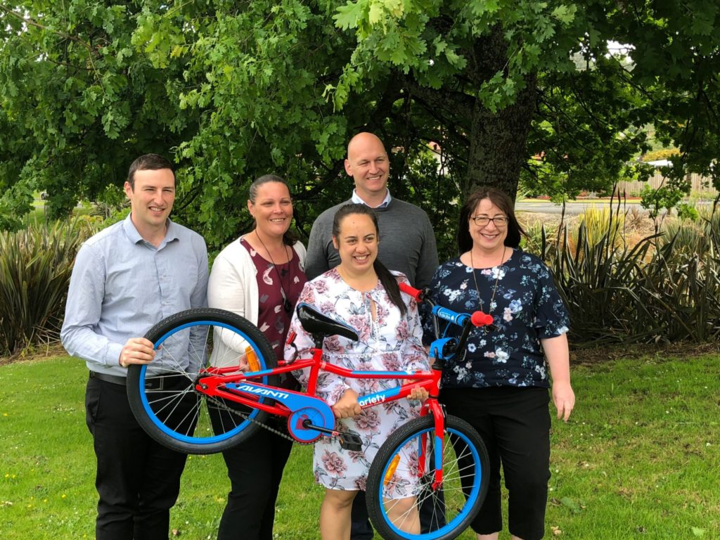 Chief Executive Sean Horgan (rear, right) and staff Matt McQuilkin, Kim Matthews, Kayla Hemara and Jill Searancke are excited to launch their 'Bikes for Christmas' campaign for children in TLC's network area