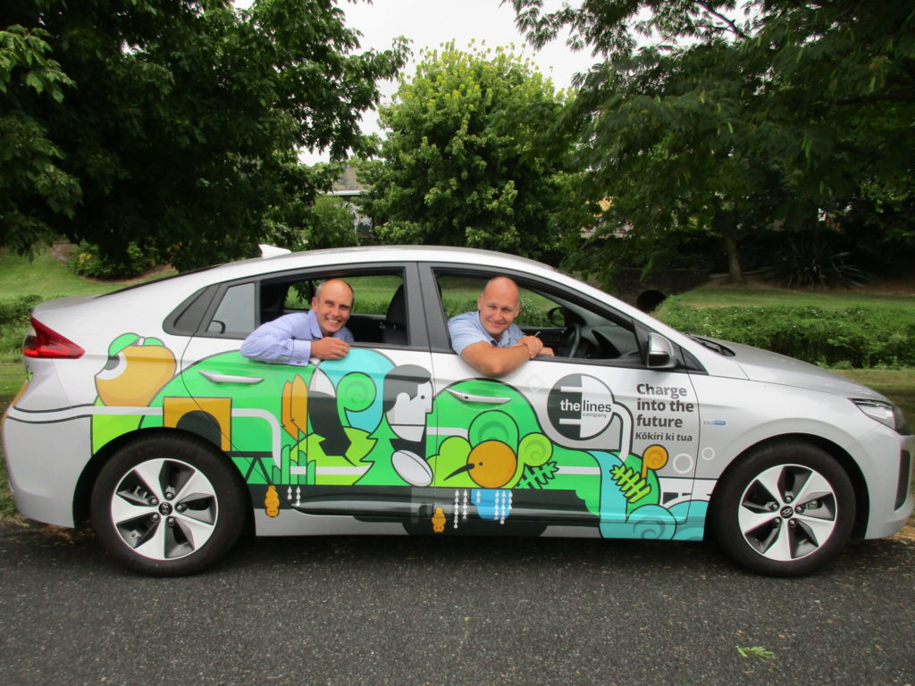 TLC's network general manager Mike Fox (left) and chief executive Sean Horgan showcase TLC's first electric vehicle (EV).