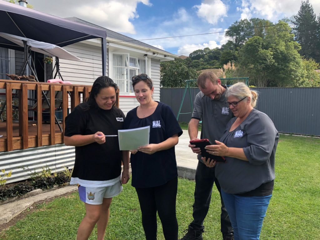 Te Kuiti resident Huatahi Hill (left) discusses the insulation assessment process with WISE Charitable Trust general manager Tracey Bryant (centre), team leader/assessor Harley Meston and operations administration supervisor Denzil Williams.