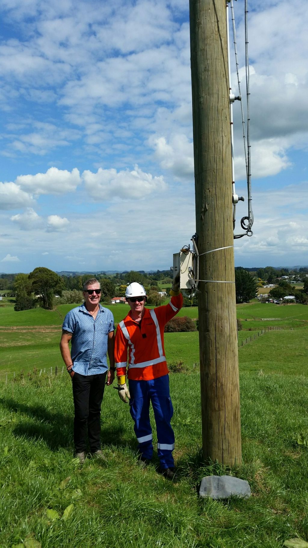 Mayor Max Baxter and TLC's Tony Gannon ensure Otorohanga's TLC Easter Cross shines across the district